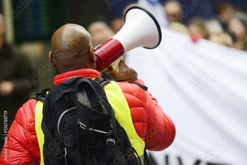 Papiers peints Rouge, noir, blanc an activist with megaphone on the protest action