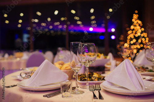 Christmas buffet, table and wine glasses,catering Fototapete