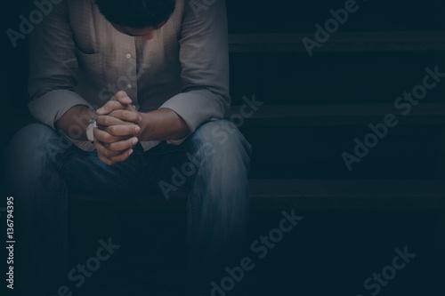 stressed man in the dark. Fototapet