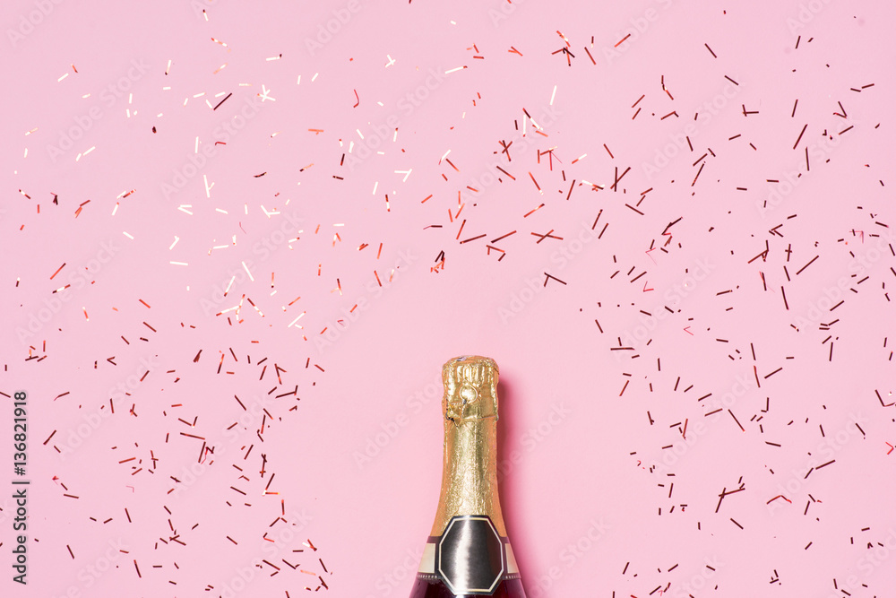 Fototapeta Flat lay of Celebration. Champagne bottle with colorful party st