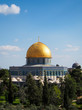 Trees in the foreground of view of Dome of the Rock Mosque in Jerusalem Israel.