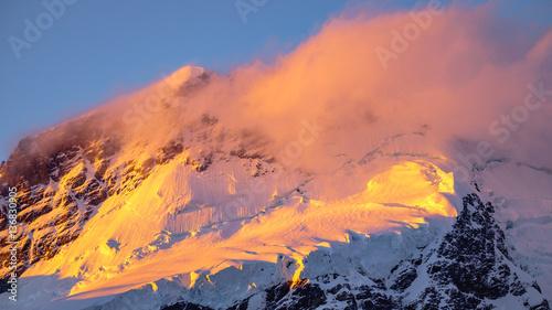 Papiers peints Corail Landscape detail of glacier in colorful golden sunset, NZ
