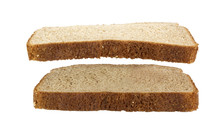 Slice Of Wheat Bread Suspended Over Another Slice Of Wheat Bread. Isolated.