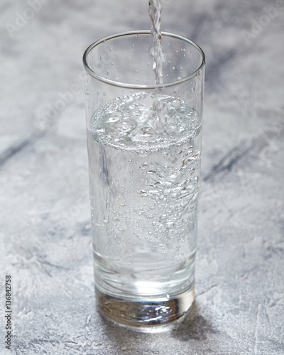 Foto op Canvas Alcohol a glass of cool water