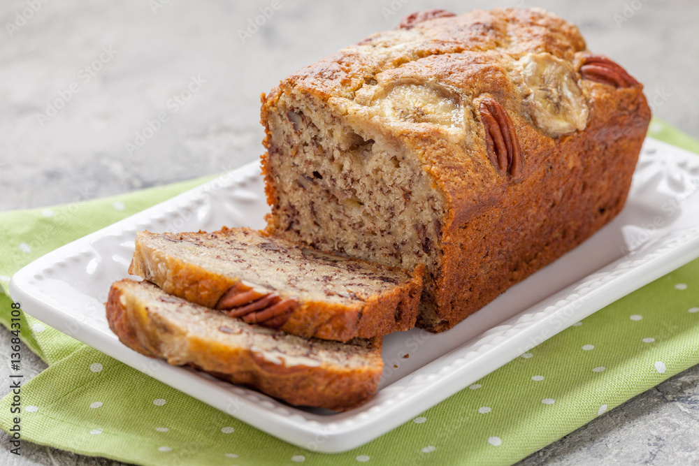 Sliced banana bread with a pecan