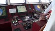 Devices of control ship in captain cabin. Closeup. Wilderness. Extreme tourism and travel in the cold polar north. Scenic coastline and blue water.