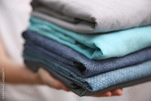 Fotografie, Obraz  Woman holding folded clothes in hands, closeup