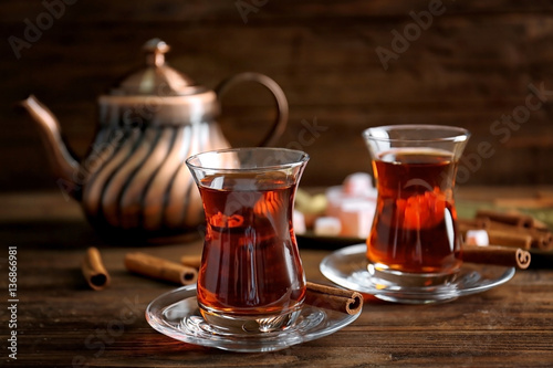 Recess Fitting Tea Turkish tea in traditional glass on wooden table closeup