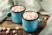 Cups Of Hot Cocoa With Marshmallows On Table