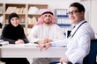 Doctor consulting arab family at hospital
