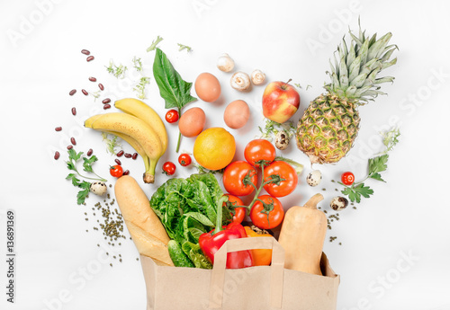 Paper bag of different health food on a white background