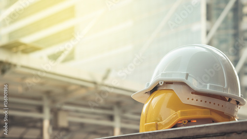 Fotografie, Obraz white, yellow hard safety helmet hat for safety project of workm