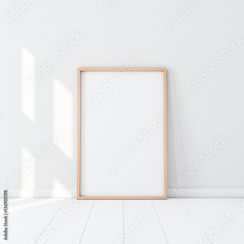 Wooden Frame with Poster Mockup standing on the white floor. 3d rendering Wall mural