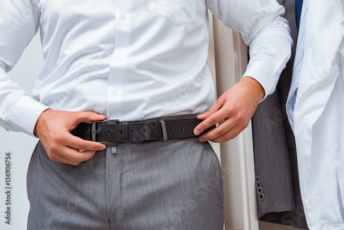 Photo Stands Martial arts Businessman dressing up for work