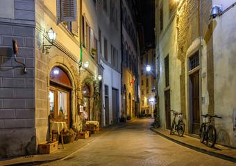 Fototapeta Night view of narrow street in Florence, Tuscany. Italy