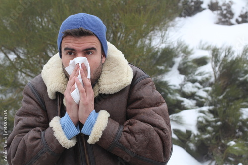 Valokuva  Man blowing his nose in the cold weather