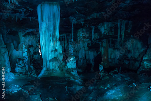 Fotografie, Tablou Speleothems with blue light in a cave