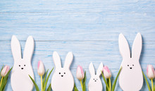 Easter Background With White Rabbits And Pink Tulips, Wooden Background, Top View