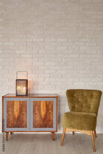 Photo  Lantern on wooden commode