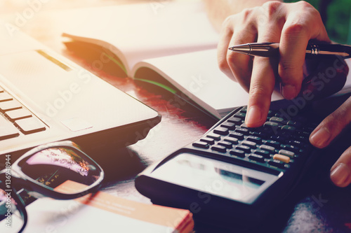Close up woman doing finance at home office with calculate expen Canvas Print