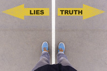 Lies Vs Truth Text Arrows On Asphalt Ground, Feet And Shoes On F