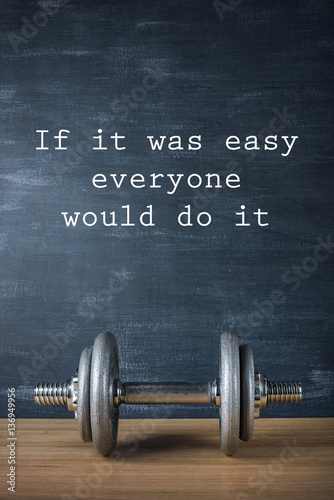metal barbell on dark gray background and motivation text Fotobehang