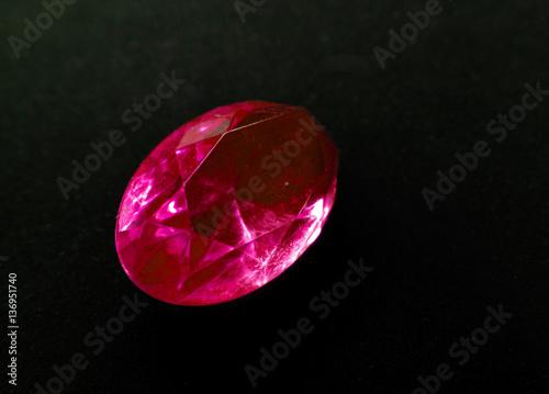 Fotografía  ruby gem crystal precious jewel on black background