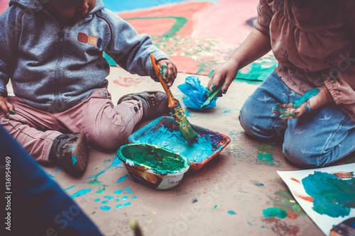 Children playing with tempera paints