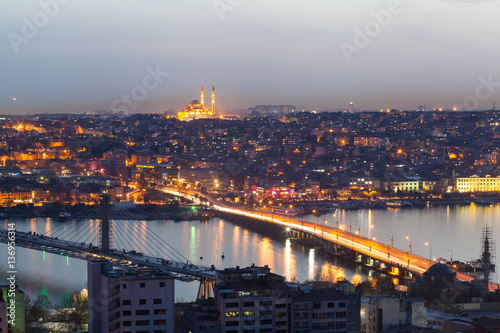 Panoramic views of the Bosphorus and the old part of Istanbul with lots of mosques illuminated at night Poster