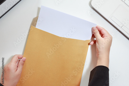 Fototapeta Businesswoman hands holding the blank paper in envelope - business obraz