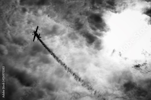 Silhouette of an airplane with smoke; Canvas Print