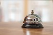 Support and service bell in hotel on blurred background.
