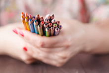 Bunch Of Colored Pencil In Wom...