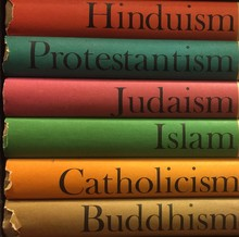 Colorful Stack Of Religious Books In Hinduism, Protestantism, Judiasm, Islam, Catholicism, Buddhism