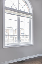 Empty Light White Room Wall In House With Large Arch Shape Window