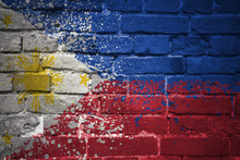 Painted National Flag Of Philippines On A Brick Wall