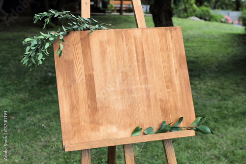 Wooden easel with a board. Wallpaper Mural