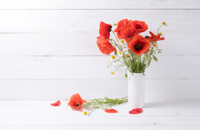 Poppies And Daisy In Vase On Background Of Shabby Wooden Planks