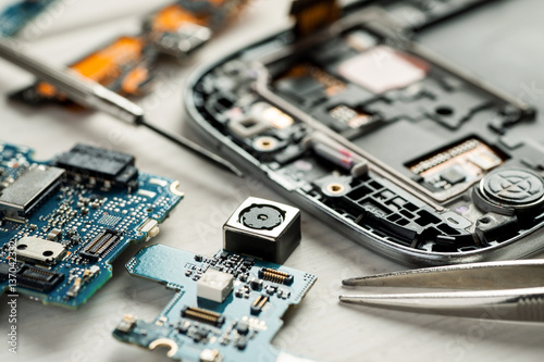 Parts of digital gadgets with tools. Repair and service concept