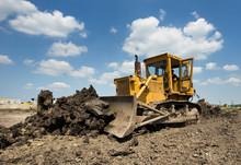 Bulldozer Moving Earth On Sunn...