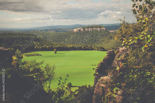 In de dag Khaki The Elbe Sandstone Mountains represent one of the most spectacular hiking regions in Europe. The bizarre, primeval landscape of the Saxon Switzerland simply overwhelms visitors.