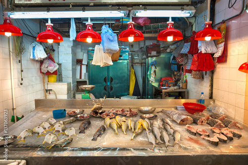 Fresh seafood on sale at a Hong Kong indoor food market Poster