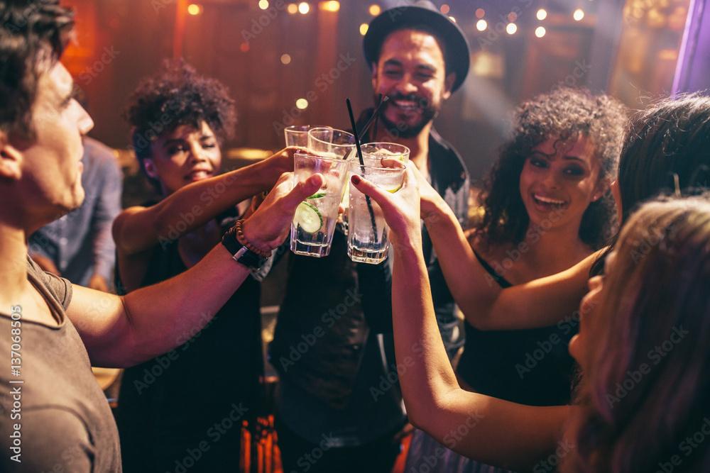 Fototapeta Friends having drinks at the night club party
