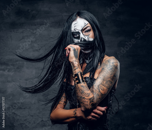 A woman with painted skull ...