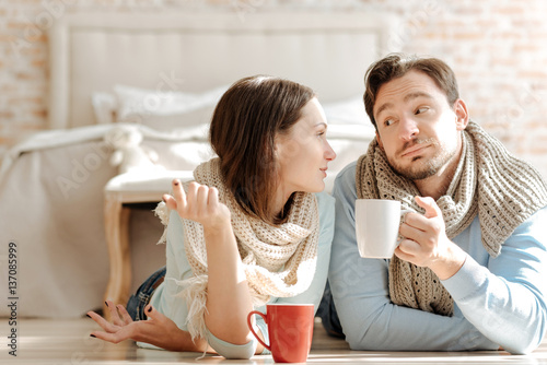 Friendly young couple communicating at home