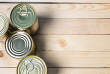 Tin Cans For Food On Wooden Ba...