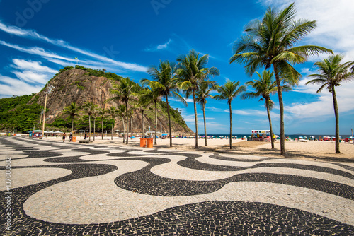 Famous Mosaic of Sidewalk and Palm Trees in Leme and Copacabana Beach in Rio de Janeiro, Brazil