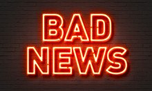 Bad News Neon Sign On Brick Wall Background.