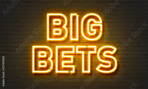 Tela Big bets neon sign on brick wall background.
