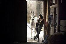 Woman With White Horse In Shed